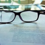 glasses-on-top-of-document