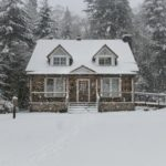 House-covered-in-snow-during-storm