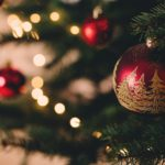 close-up-of-an-ornament-hanging-on-a-lit-Christmas-tree